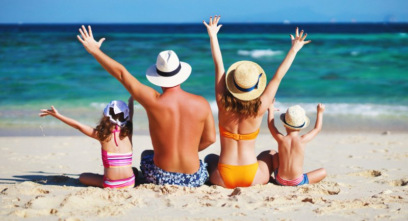 family at the beach during summer vacation