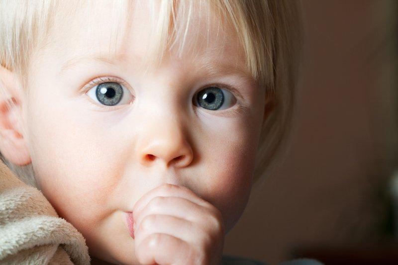 Closeup of child sucking their thumb